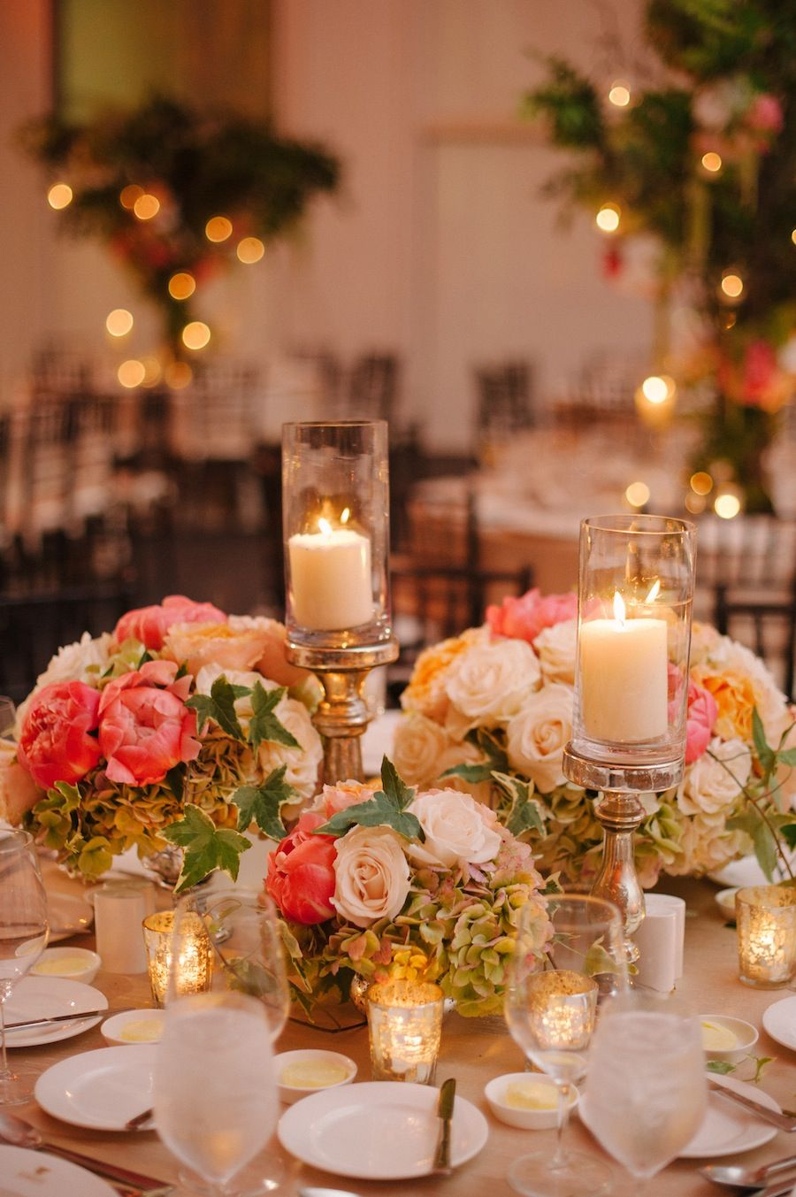 An Example Of A Concept For Low Centerpieces We Like The Mix Smaller Arrangements With Diffe Candle Heights And Mercury Votives Round Table