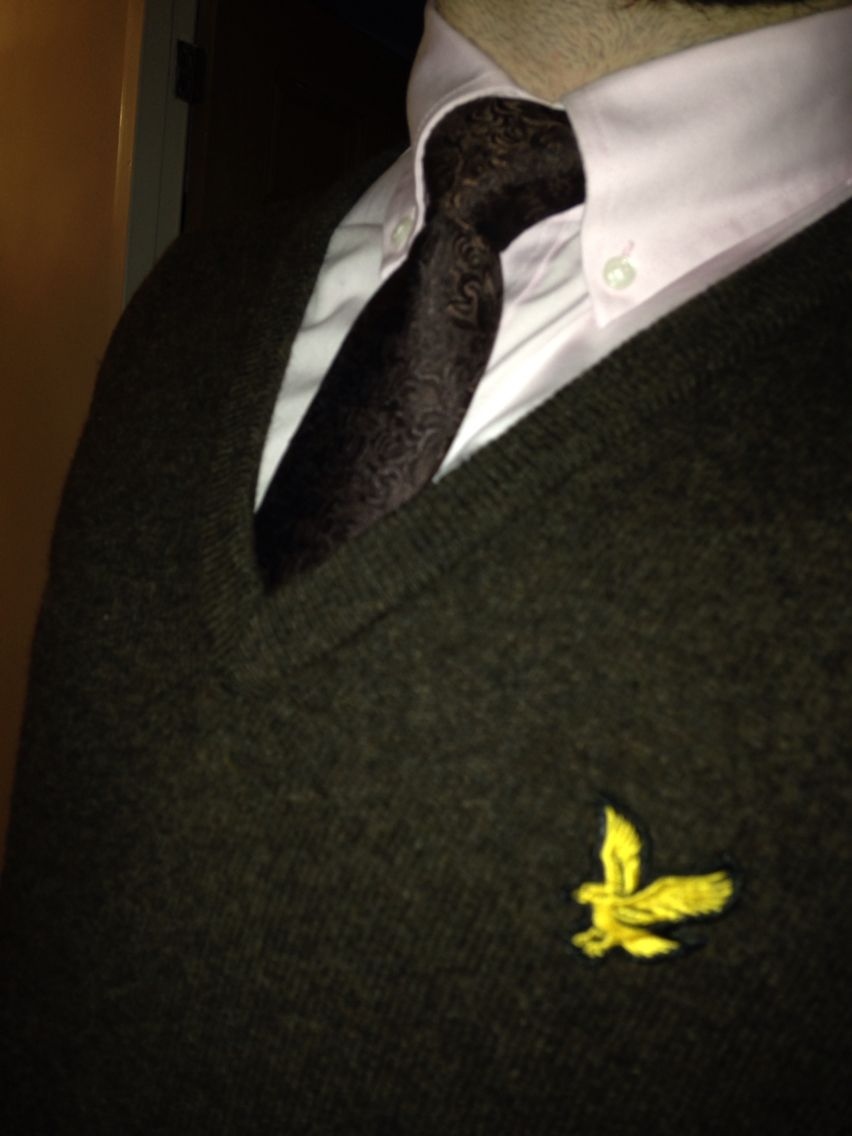Brown Lyle & Scott v-neck jumper with pink shirt & brown Paisley tie.
