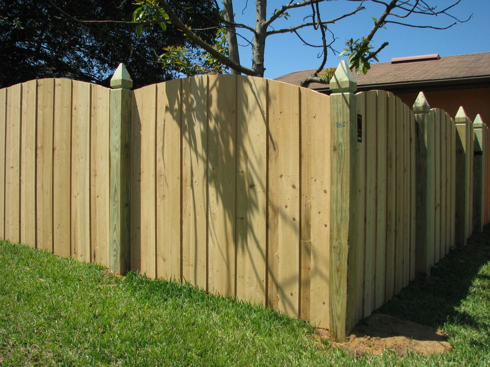 scallop cut wood privacy fence design