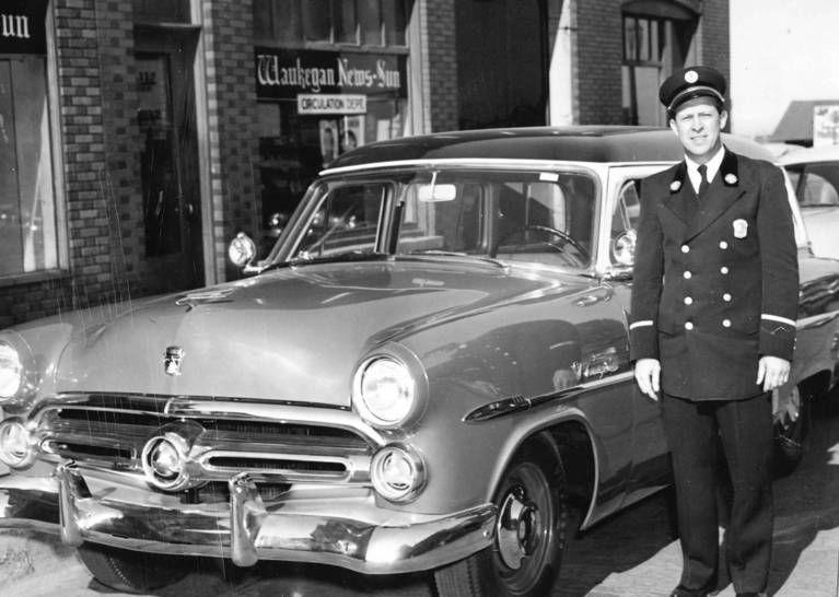 Waukegan Fire Chief Norman Litz stands by a recently