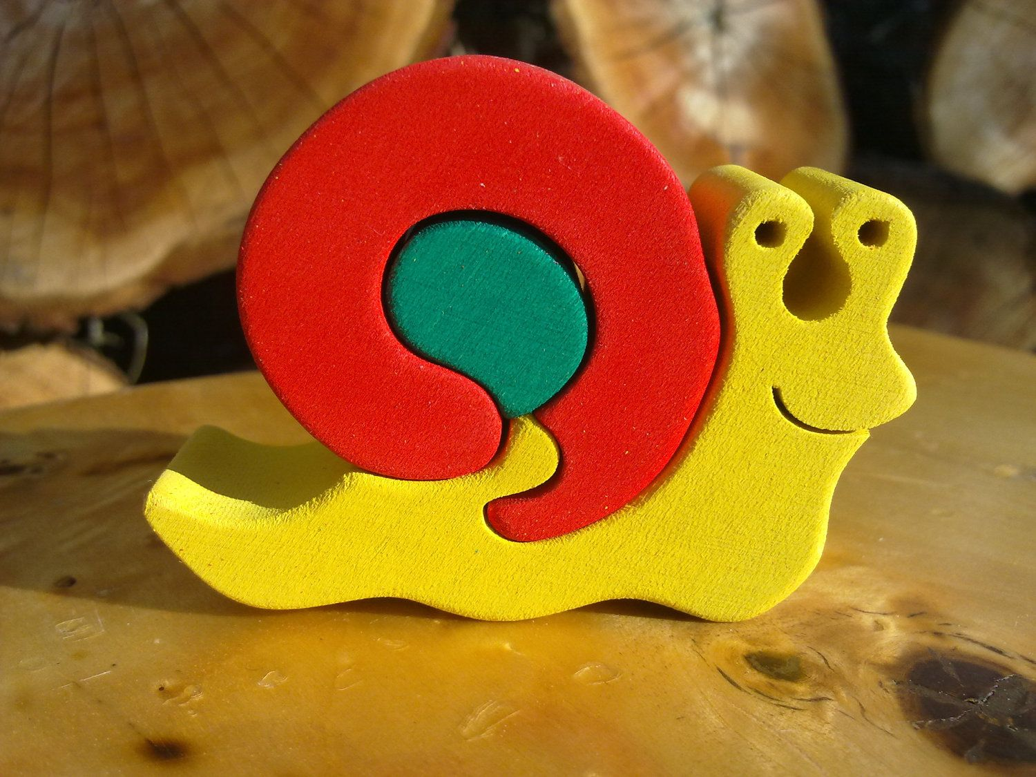 Snail-Montessori - Waldorf wooden puzzle, made by hand of maple wood,no harmful colors and no lacquer. $5.00, via Etsy.