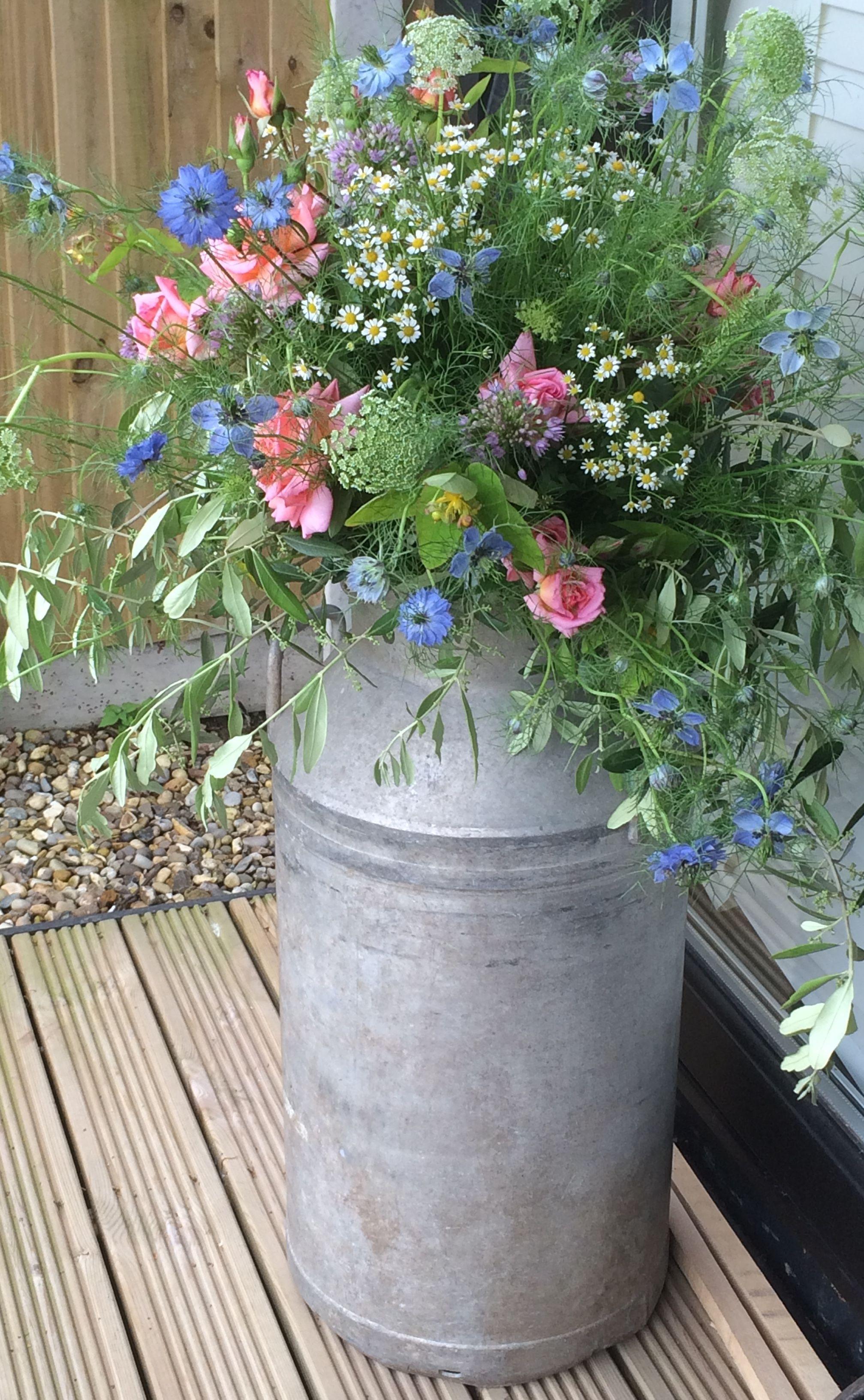 Milk Churn With Wild Flowers Milk Can Garden Ideas Spring Garden Garden Gate Design