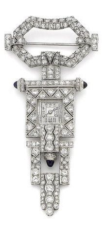 An Art Deco sapphire and diamond fob watch, circa 1925. The openwork compressed octagonal surmount, suspending a square bezel and dial with Arabic numerals, with sugarloaf sapphire finials, to a tapering geometric drop, finely pierced with millegrain details, and set with single and brilliant-cut diamonds throughout.