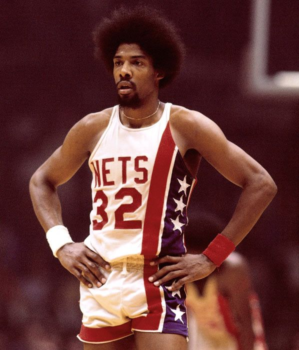 """Back-up Small Forward: They called him """"Dr."""" because he would operate on other players. The original guy with a game based in the air instead of the ground, Julius Irving was indeed not only the ABA but also revitalized the NBA. Unfortunately, without a 3-point line back then, only one title to his credit and lack of any talked about defensive skills, the past (despite its great nostalgia in the form of the coolest afro ever) has to be relegated to the bench behind a far more versatile…"""