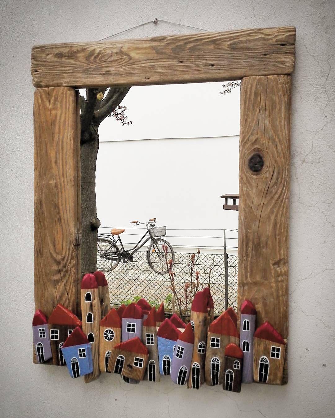 Instead of using ordinary moulding around windows .. use old wood to ...