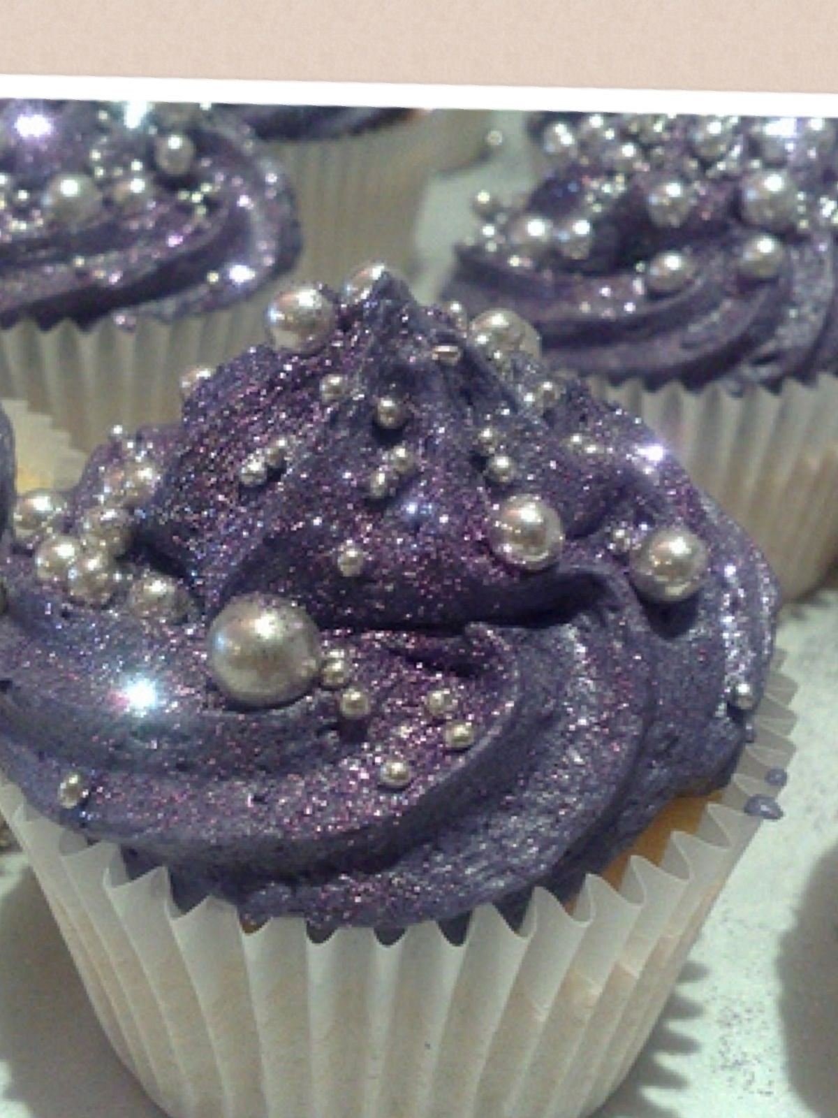 A cupcake with purple icing and silver candy balls | Cupcake cakes ...