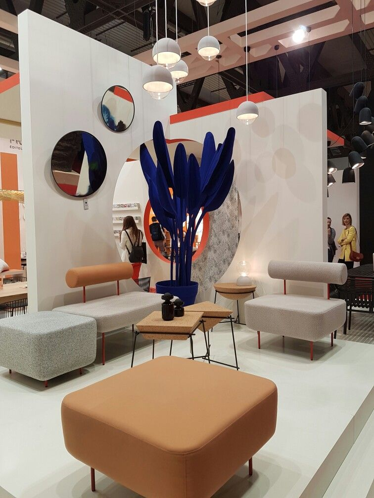 Furniture Exhibition Booth Design : Neutral tones contrast with strong blue plant feature