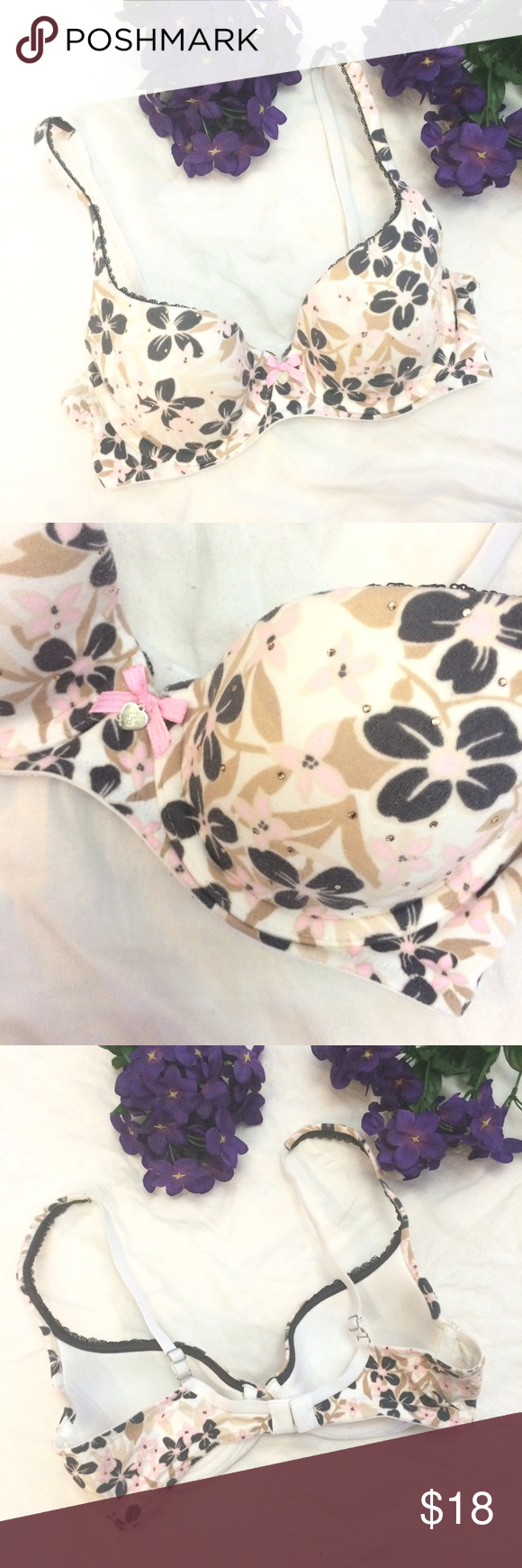 Body By Victoria Secret Demi Floral Rhinestone Bra This Body by Victoria Secret Lined Demi bra is size 34B and is cream colored with a pink and black floral print. It has tiny rhinestone embellishments and a lace trim. Also has a cute bow and VS logo dangle in the center. Does not have push-up padding. Very good used condition for slight wash wear. Victoria's Secret Intimates & Sleepwear Bras