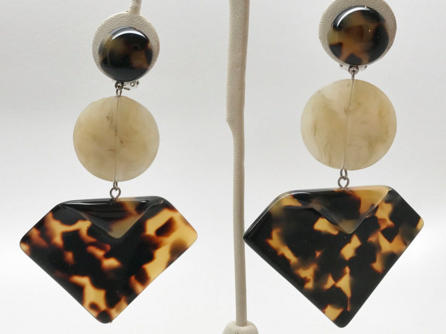 and gold silver store earrings resin clear
