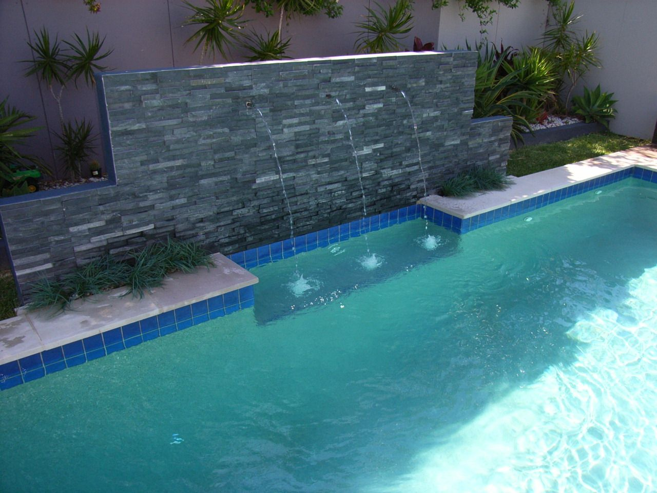 Stacked stone water feature - Stone Pool Stack Stone Feature Wall With Spouts