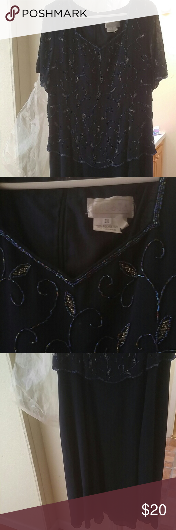 Beatiful navy blue dress with detail beading.  2xl This dress is gorgeous!  Very detailed beading, back zip.  It was worn once and kept in bag.  Would be a nice dress to wear for Ann upcoming holiday party event! Dresses