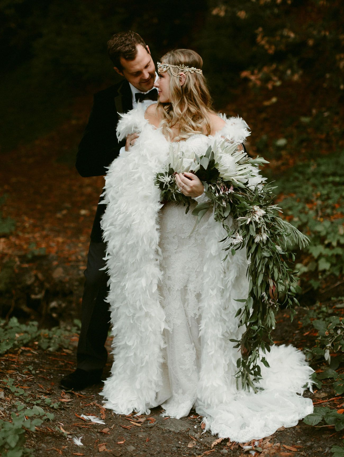 A fairytale forest wedding with a feather cape