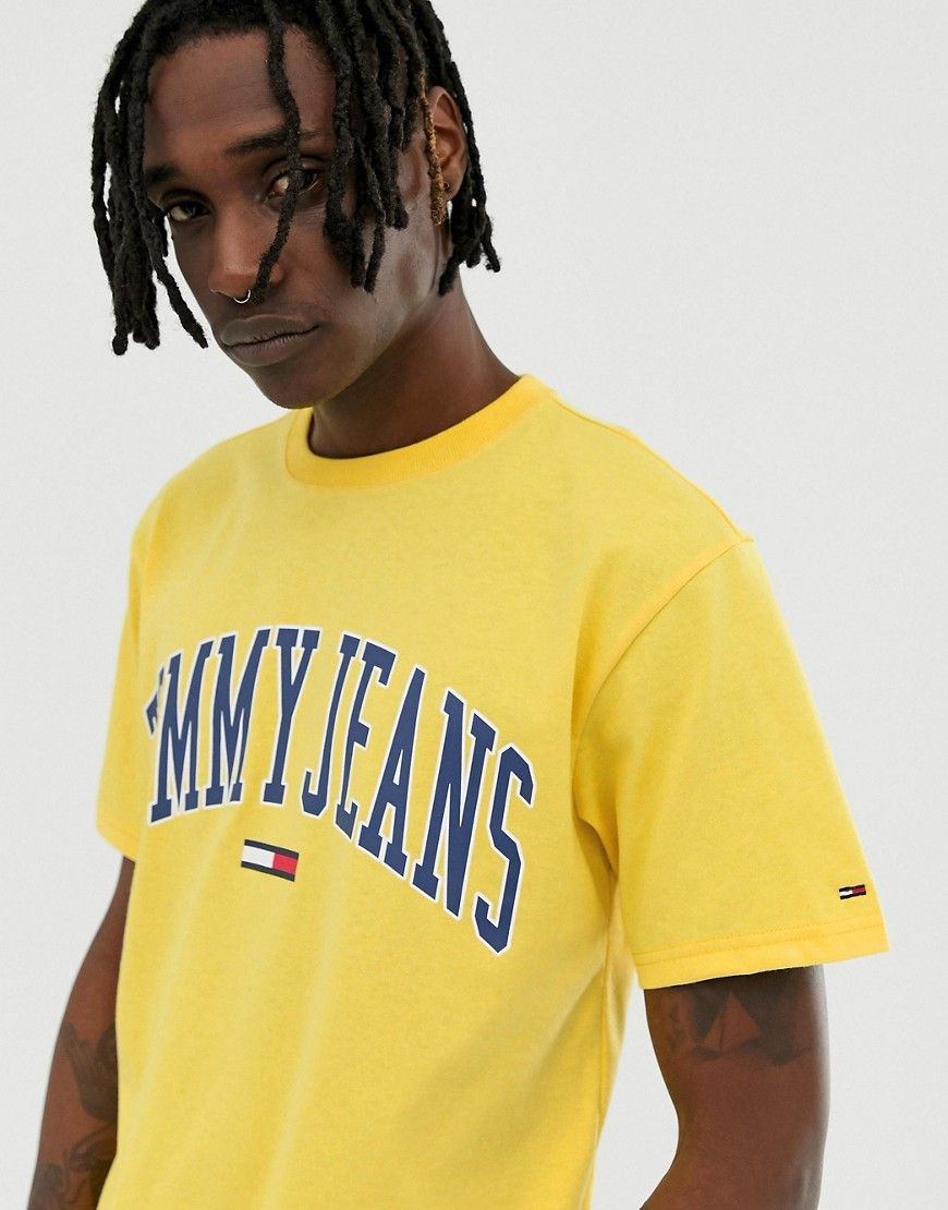 83c14bafdb47aa TOMMY JEANS RELAXED FIT COLLEGIATE CAPSULE T-SHIRT IN YELLOW - YELLOW. # tommyjeans #cloth