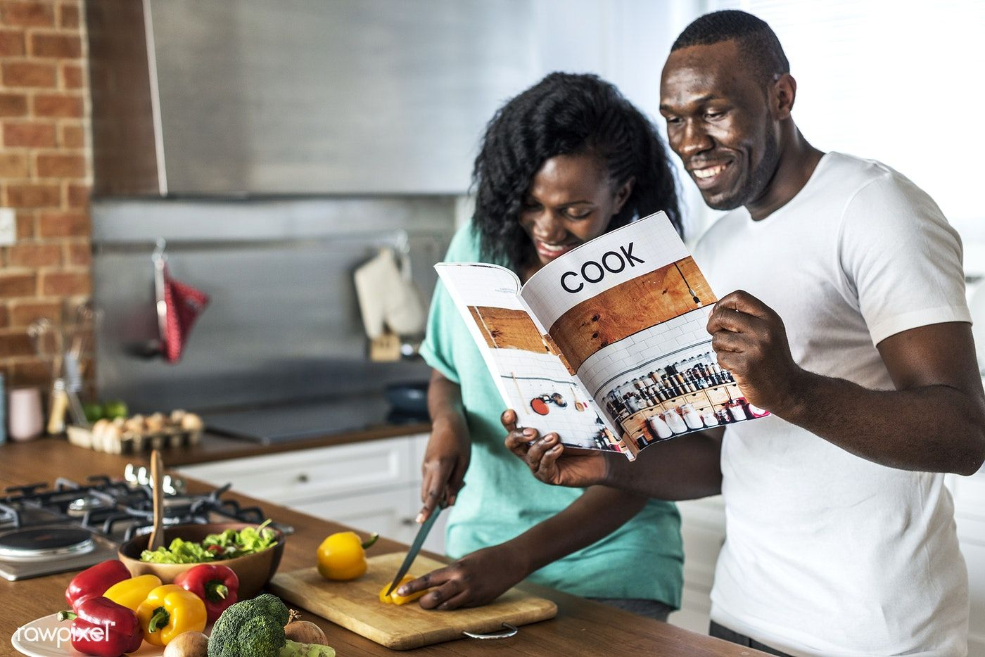 Download premium photo of couple cooking in the kitchen