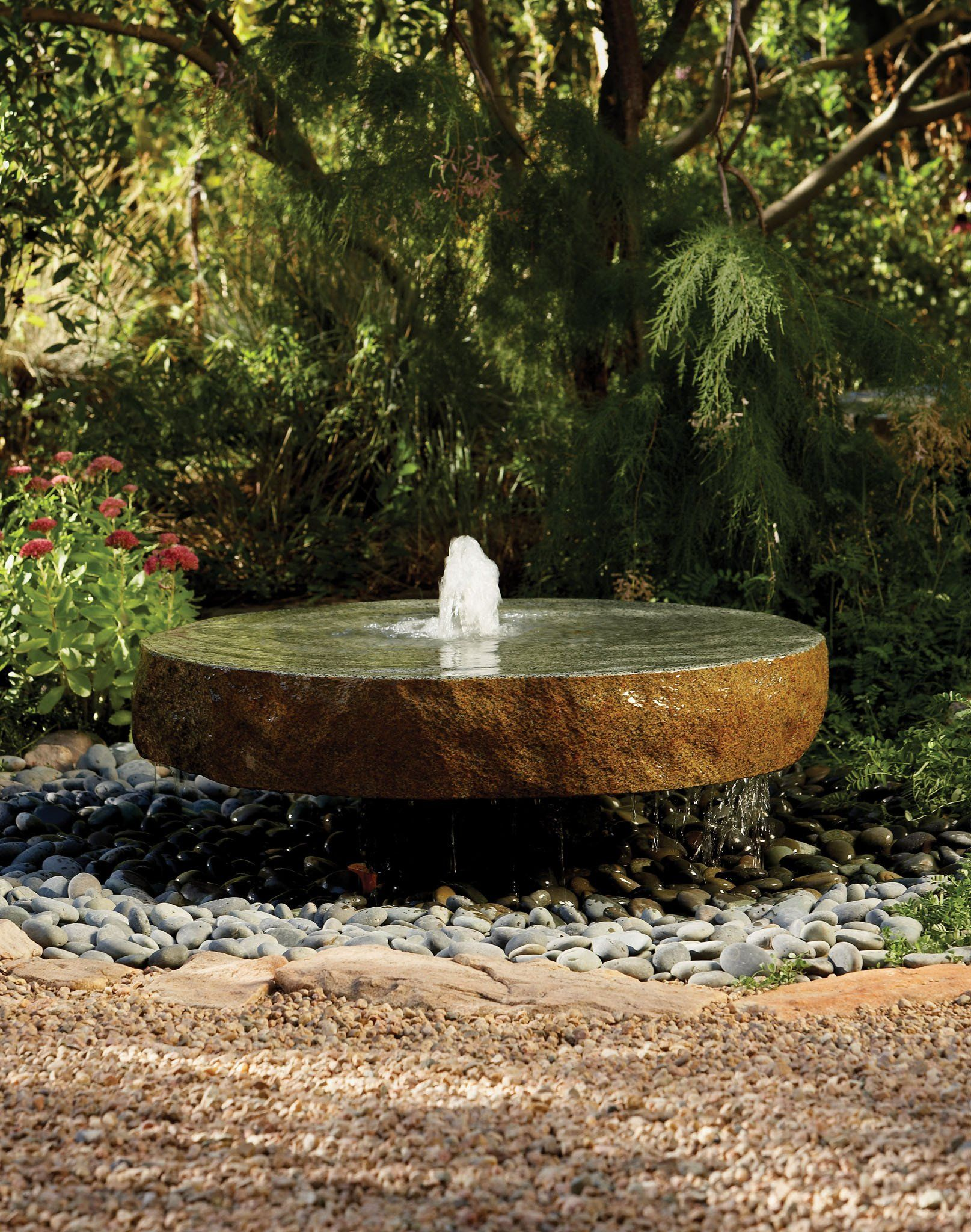 Garden Fountain natural millstone in showroom display