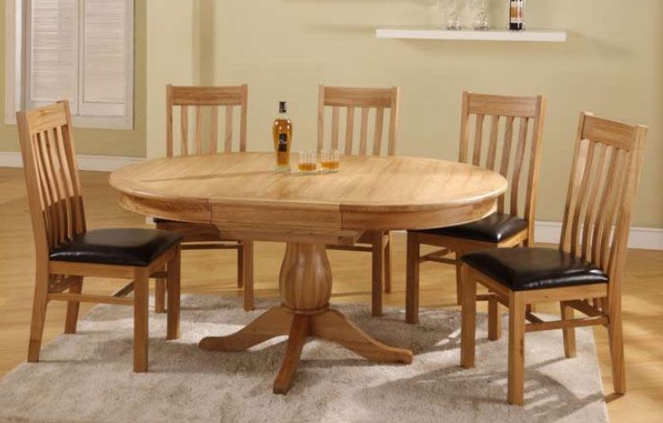 Solid Oak Oval Extending Dining Table Go To