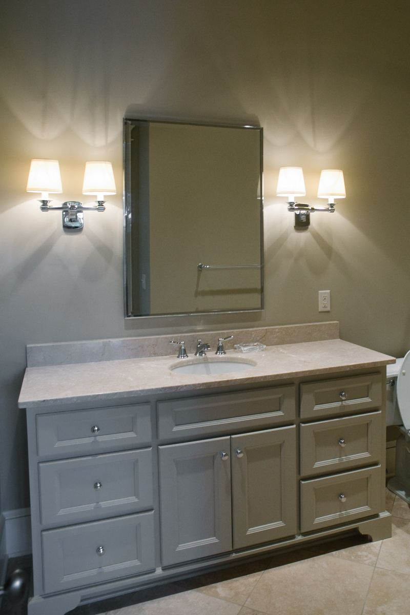 Gorgeous beige vanity in this guest bathroom! Love the dual sconces ...