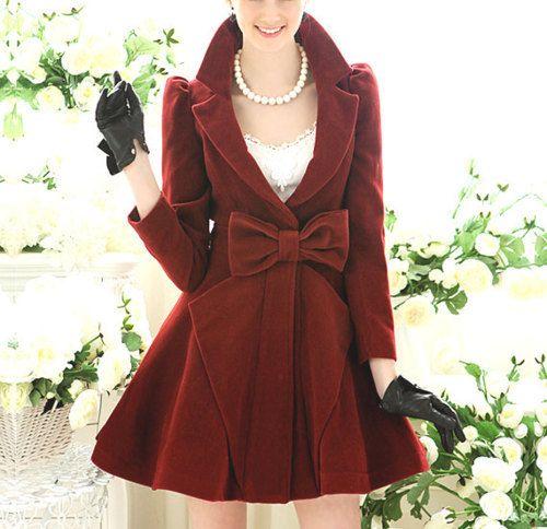 Deep burgundy velvet, bow, exaggerated neckline, flouncy skirt leather gloves and pearls.