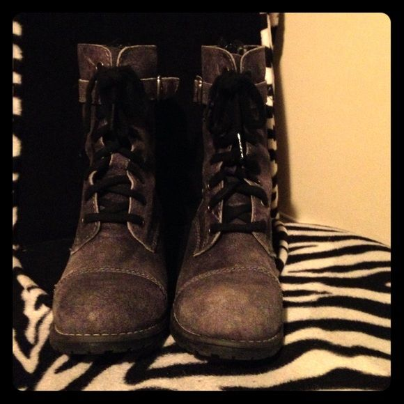 Sexy Gray combat boots These combat boots are sexy, they're lace up with 2 different designer latches and a zip up back. I'm a size 6 and they fit me perfect, even though they say 6.5. Worn once and is in perfect condition! Hard to part with these babies :( lol Shoes Combat & Moto Boots