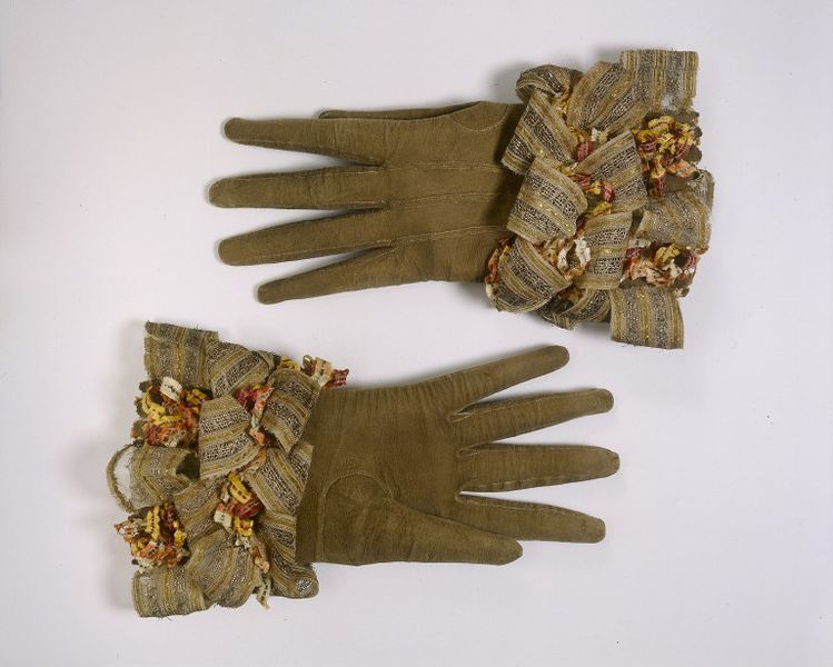 """1660-1680 English Gloves at the Victoria and Albert Museum, London - From the curators' comments: """"The increased availability of ribbons influenced fashion, particularly men's wear. Breeches, doublets (close-fitting body garments) and gloves were liberally festooned with great bunches of decorative ribbons. Moralists condemned the extravagant use of ribbons in dress, especially by men."""""""