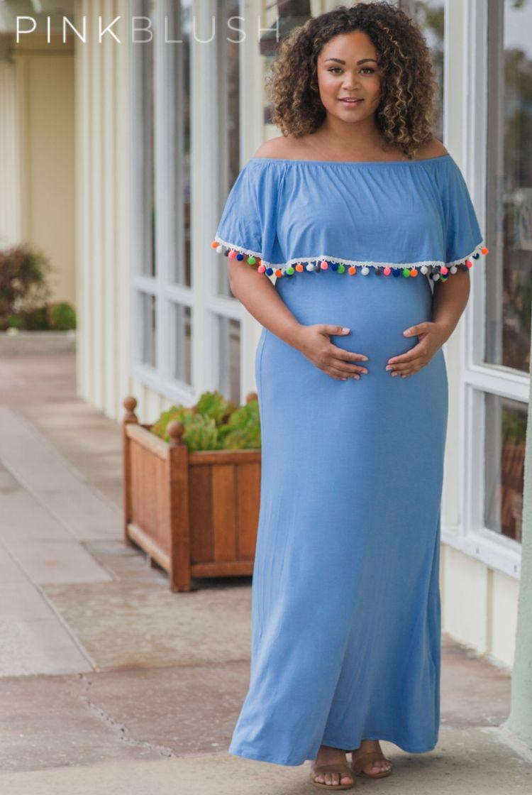 c92bf2fb0e106 Solid off shoulder plus size maternity maxi dress. Pom pom tassel trim.  Short sleeves. Cinched at neckline and under bust.