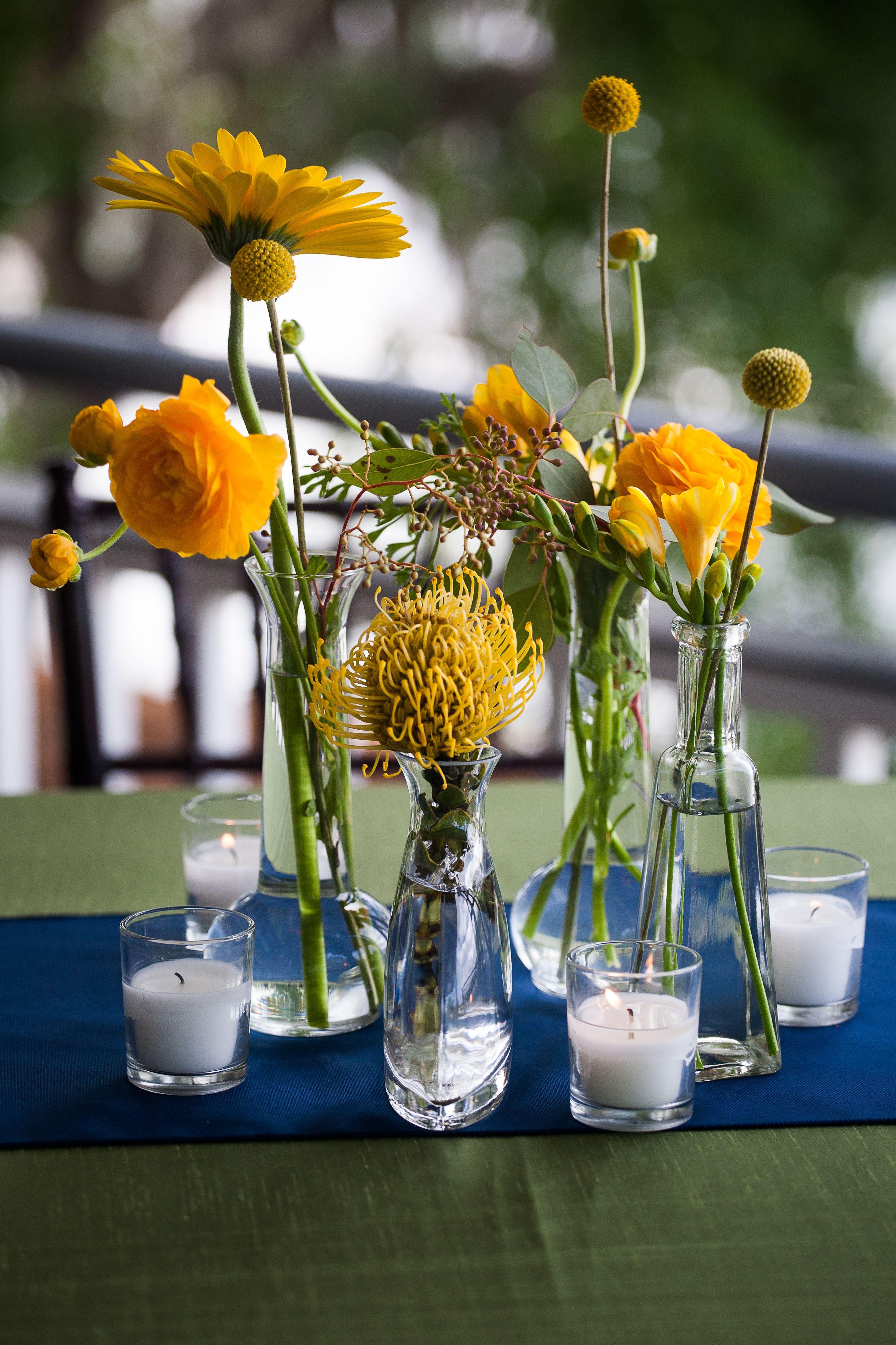 Yellow billy balls ranunculus pin cushion protea and gerber yellow billy balls ranunculus pin cushion protea and gerber daisies in bud vases reviewsmspy