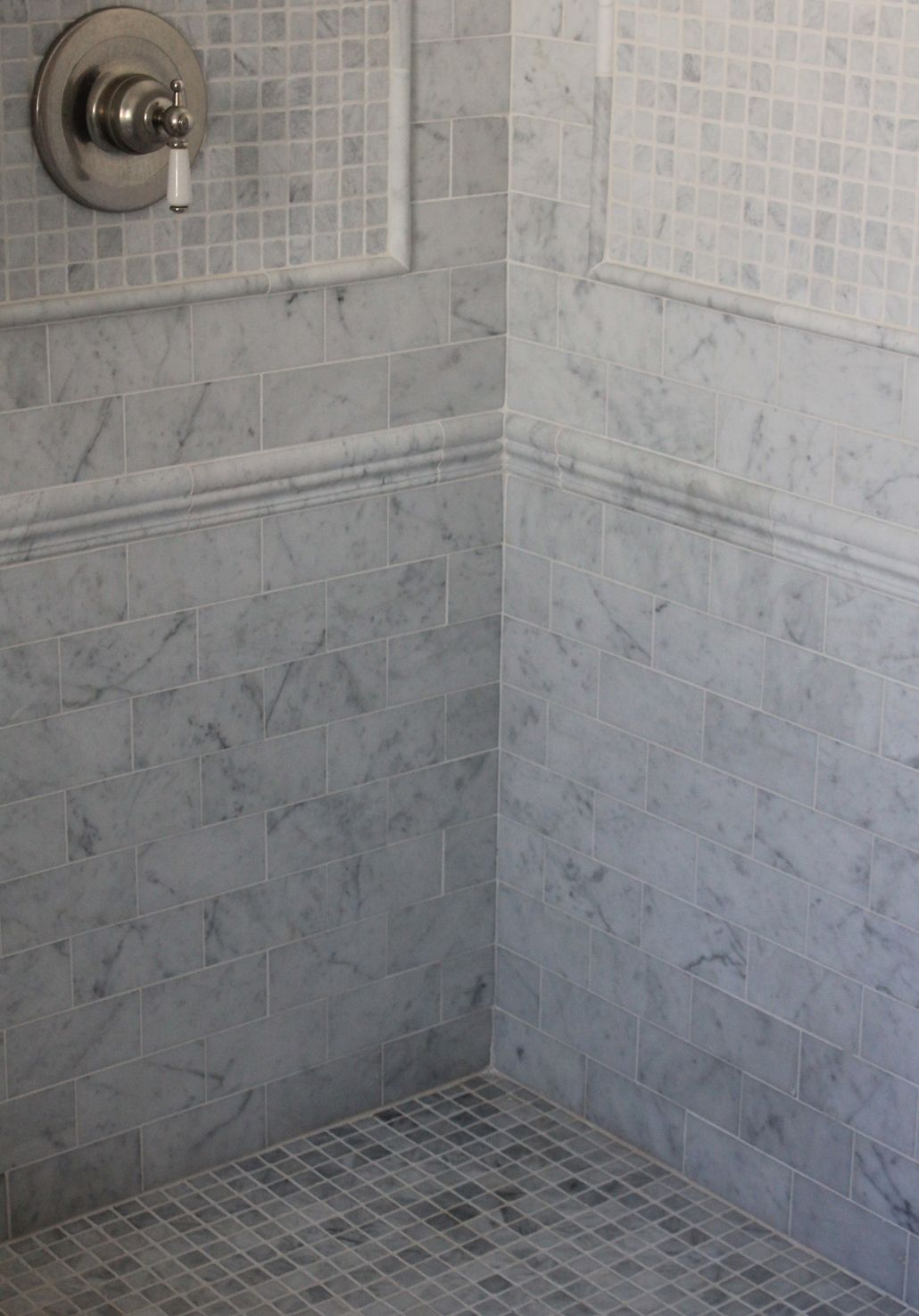 3x6 marble tile shower with chair rail and marble mosaic