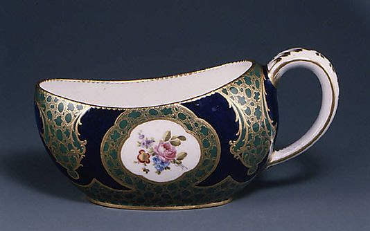 1757-1758 French Sèvres chamber pot at the Metropolitan Museum of Art, New York - Looking at the elongated oval shape of this piece, I think it was specifically a bourdaloue: a chamber pot designed to allow women to use them without disrobing or attempting to squat while in large and cumbersome dresses.  These would be discreetly slipped underneath the skirt and held between the thighs when in use; if executed with grace, a woman could use one standing up.