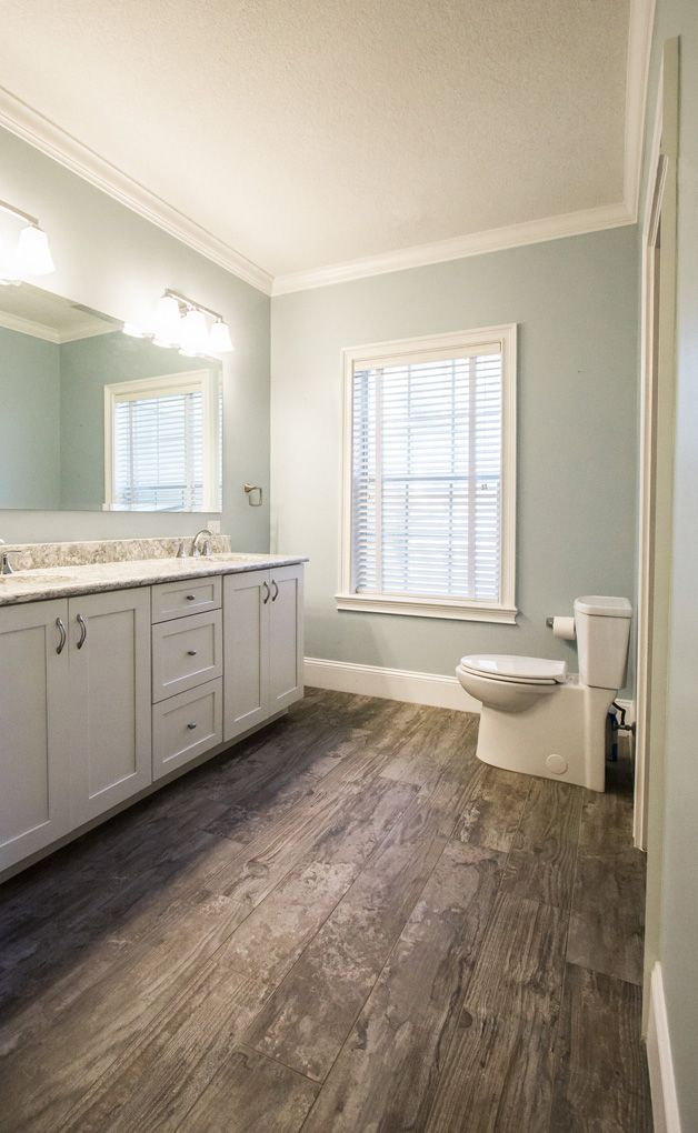 MB_Sherwin Williams 'Tradewind' wall color brings a tranquil mood to this  bathroom remodel.