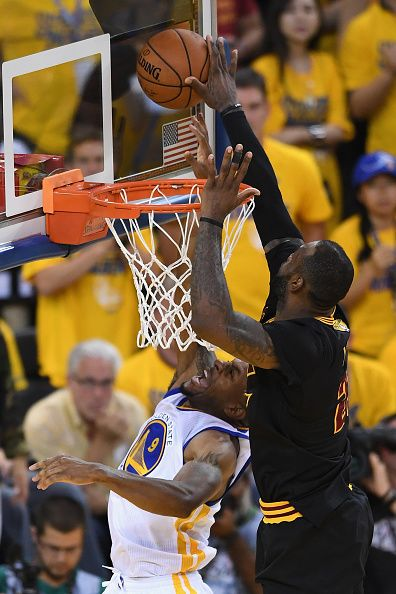 LeBron James of the Cleveland Cavaliers blocks a shot by Andre Iguodala of  the Golden State Warriors in Game 7 of the 2016 NBA Finals at ORACLE Arena. 82a47fb26