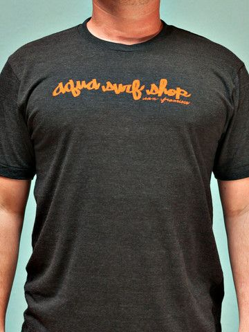 Aqua Script Tee - Jeremy Fish busted out this classic script for us, and did we mention he let's us borrow his van sometimes for zombie films, he is pretty kind! Seen here on a heather black tee with orange screen print.