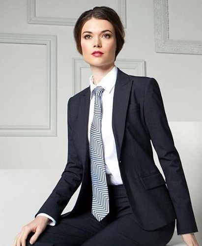 Dressed For Work In Pants Suit White Shirt And Tie Women Wearing