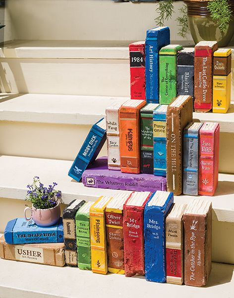 Bricks painted to look like books for outdoor decorating. Link to ...