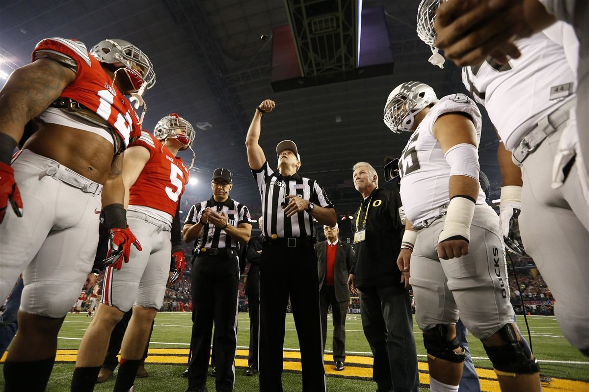 Coin Toss Prior To Kickoff Of Uovsosu College Football Playoff