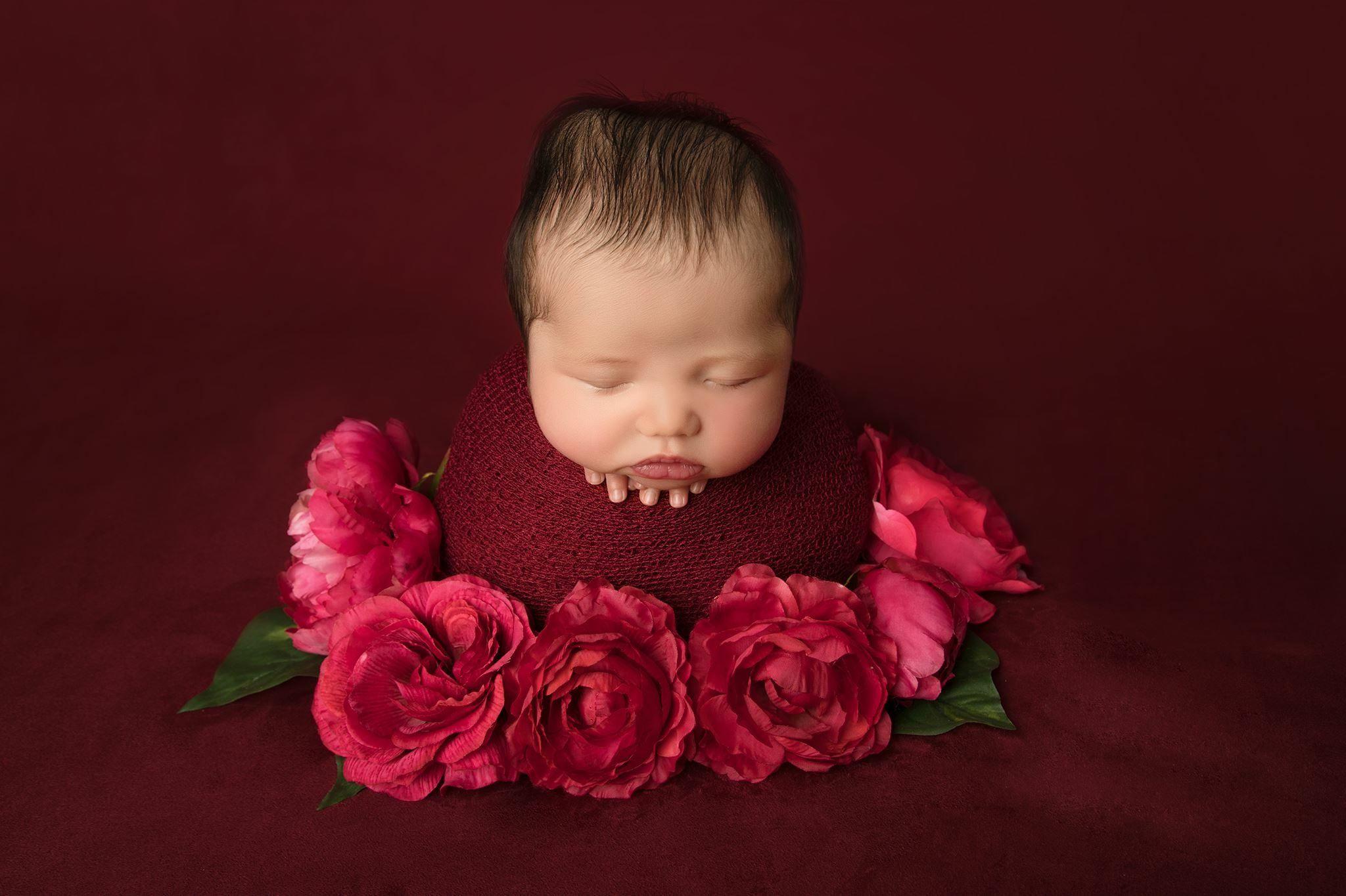 Andrea godfrey photography newborn photography potato sack pose burgundy 15 days old floral baby