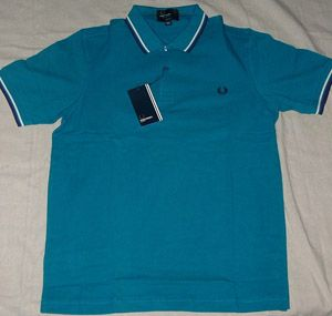 Fred Perry Teal Polo $72.00 Detailed Description (Teal Polo with off white and purple piping, Made in China slim-fit, LARGE ONLY) http://www.drstrange.com/punk-rock-clothing/fred-perry-polos-shirts/Fred-Perry-Teal-Polo-p1647870.html