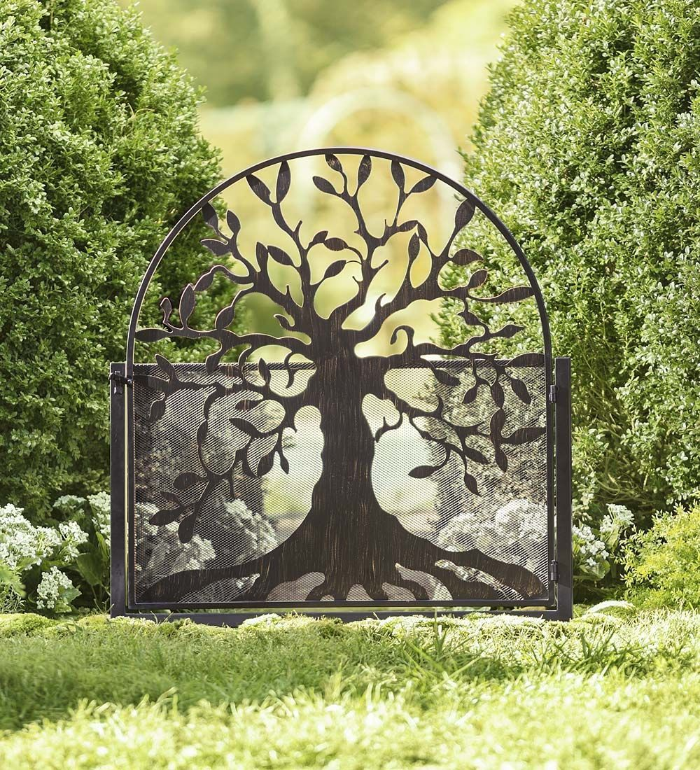 Metal garden gate with tree of life design shut the front door
