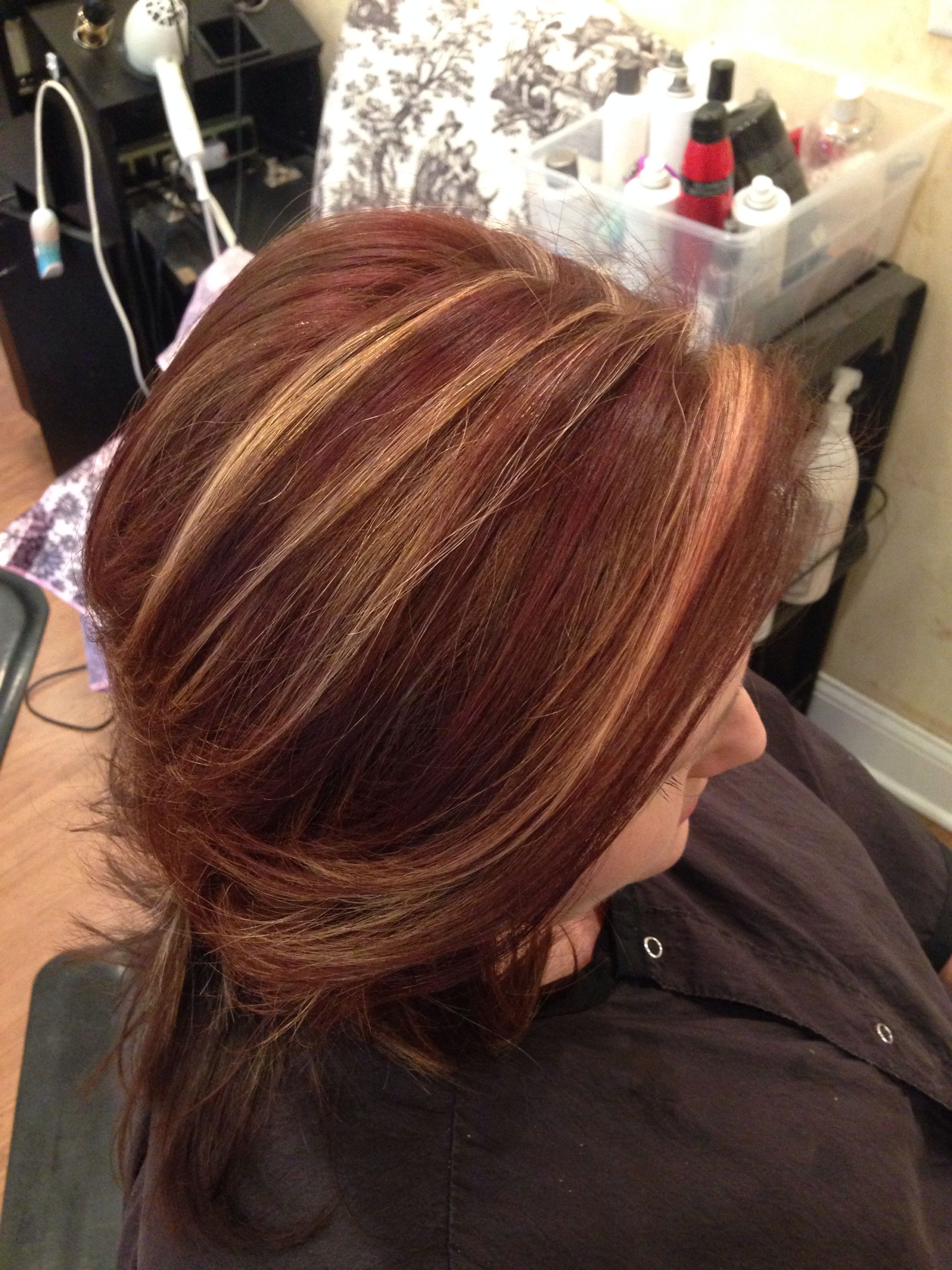 Warm blonde chunks with racing red and chocolate lowlights