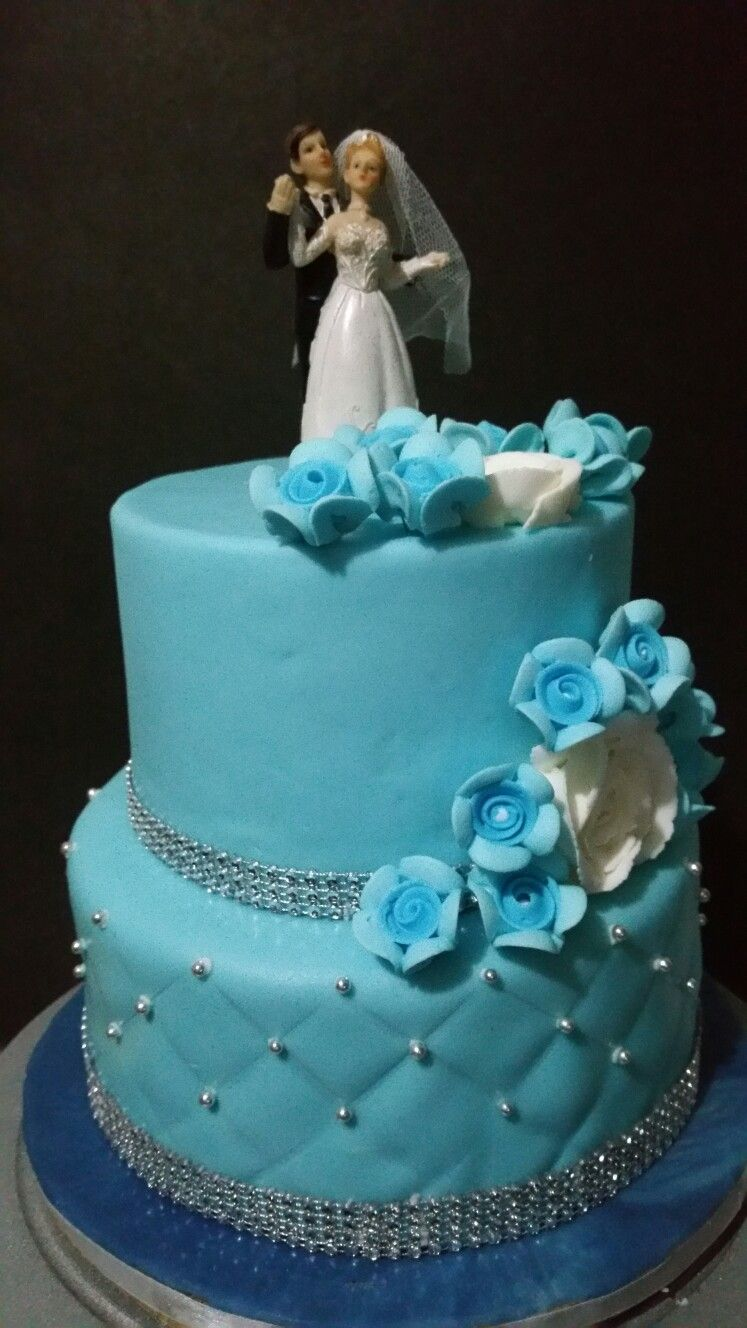 Blue and silver wedding cake with faux crystals. Made for an early wedding event