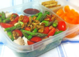 Salad with fresh romaine lettuce, cherry tomatoes, pecans, asparagus, and roasted chicken  raspberry vinaigrette, mandarin oranges, crackers.
