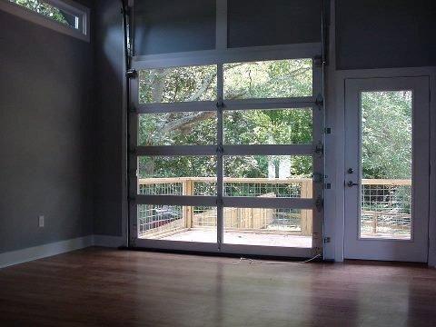 Check Out This Full View Garage Door Inside Your Living Space Who Needs A Garage Www Goodrowdoorsolutions Glass Garage Door Overhead Garage Door Garage Doors