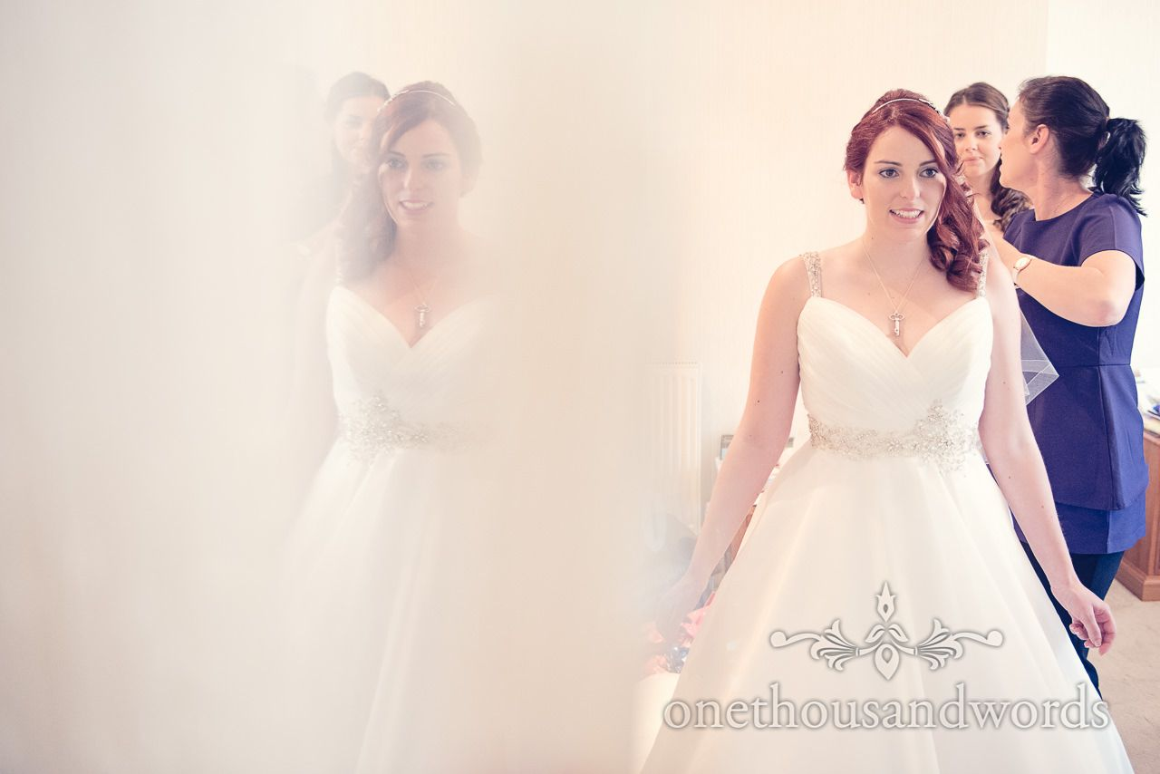 Red Head Bride in white wedding dress has veil attached at ...
