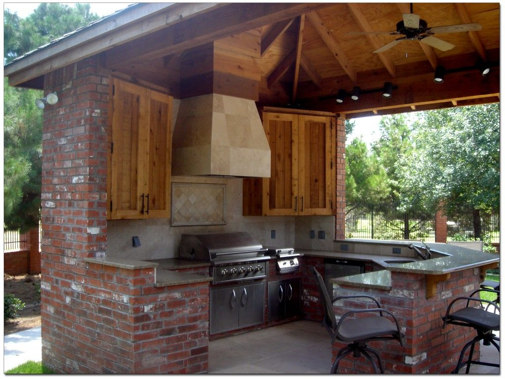 Outdoor kitchen cabin pinterest kitchens backyard for Outdoor kitchen grill hood