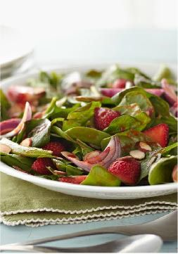 Springtime Spinach Salad – This salad boasts a lovely mix of fresh spinach, red onion, sugar snap peas and strawberries with a sprinkle of toasted almonds and a classic dressing.
