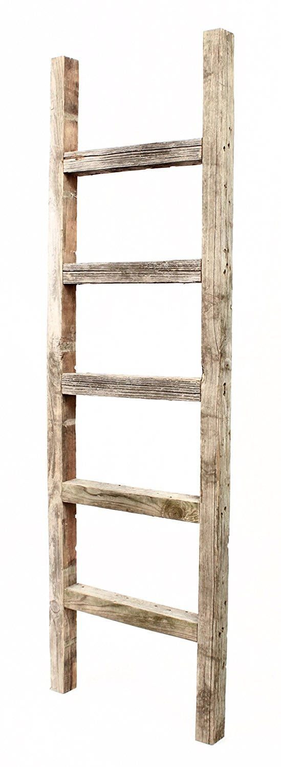 Prop up this distressedwood ladder in your home and easily display