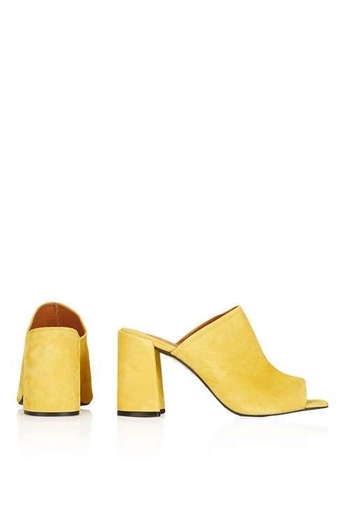 Elevate the mule trend with these vibrant peep-toes with a flared heel. Featuring a stunning suede finish in an eye-catching mustard hue, these mules are perfect to team with denim for a look that says 'off-beat cool'. #Topshop