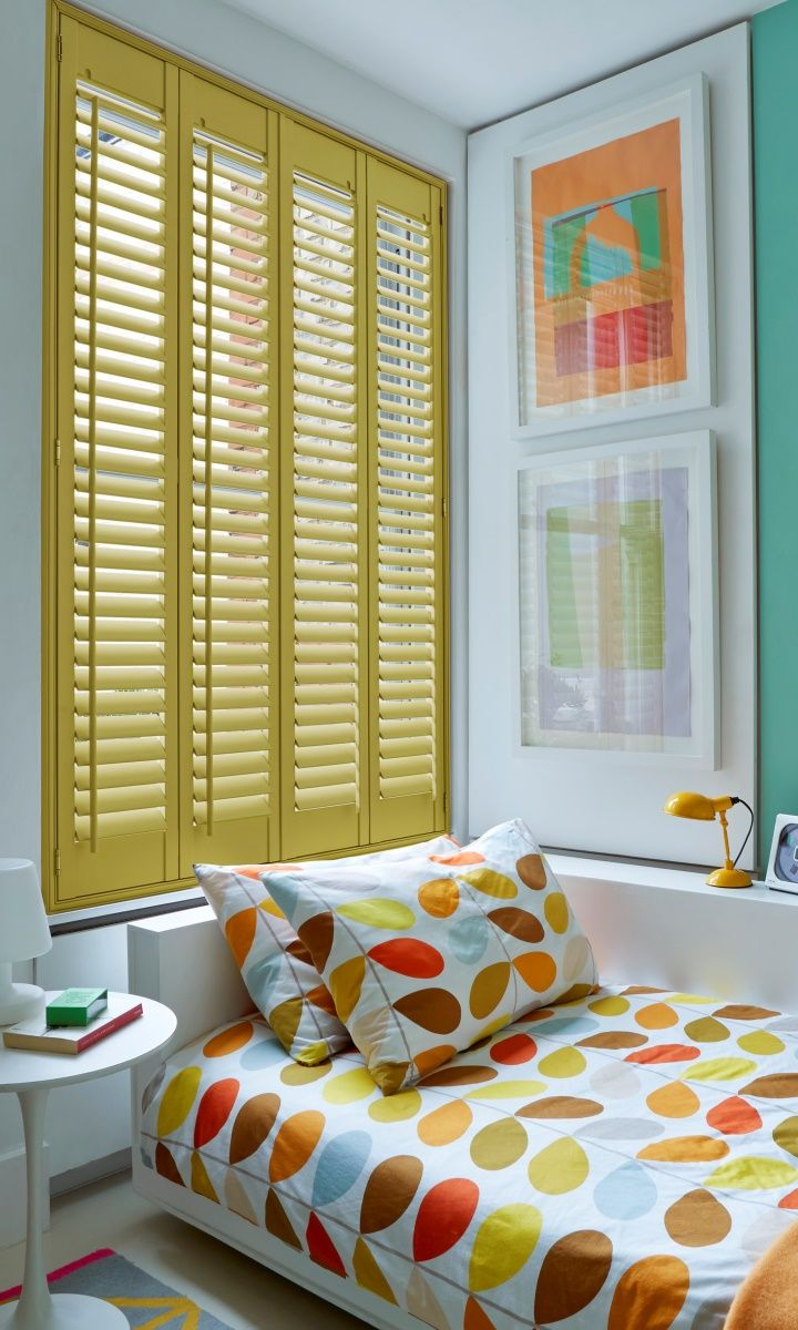 Retro prints in bright colours bring life to a room