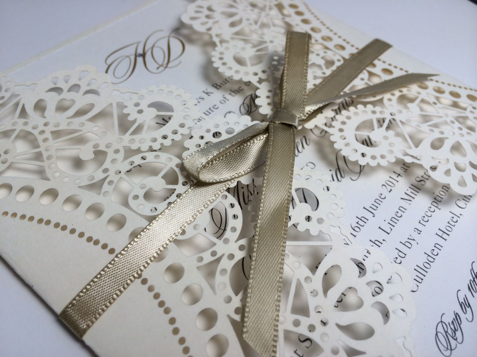 Vintage Lace laser cut invitation with golf bow from www.whitelacestationery.co.uk