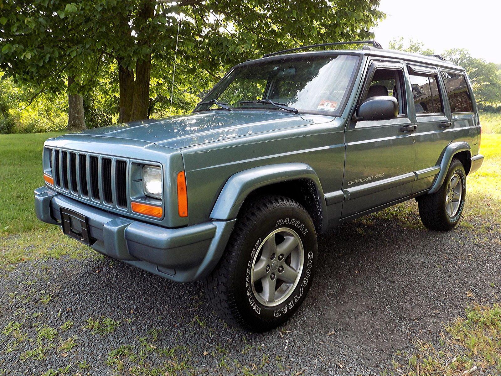 Car brand auctionedJeep Cherokee Classic Sport Utility 4