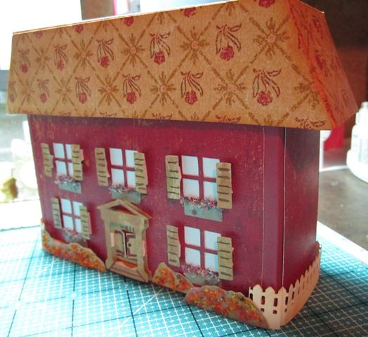 Here is a stationary box that I made and I changed it to look like a little house. This is the box closed with the top/roof on. More details and file download at my blog here... http://cutbyconnie.blogspot.com/2011/07/stationary-box.html